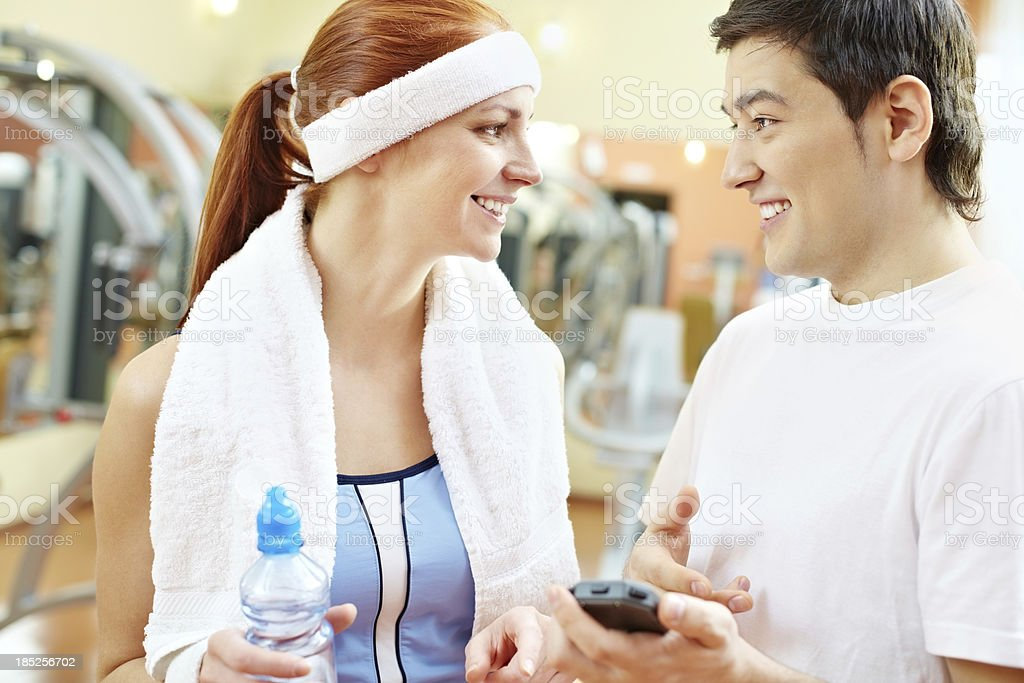 Communication in gym royalty-free stock photo