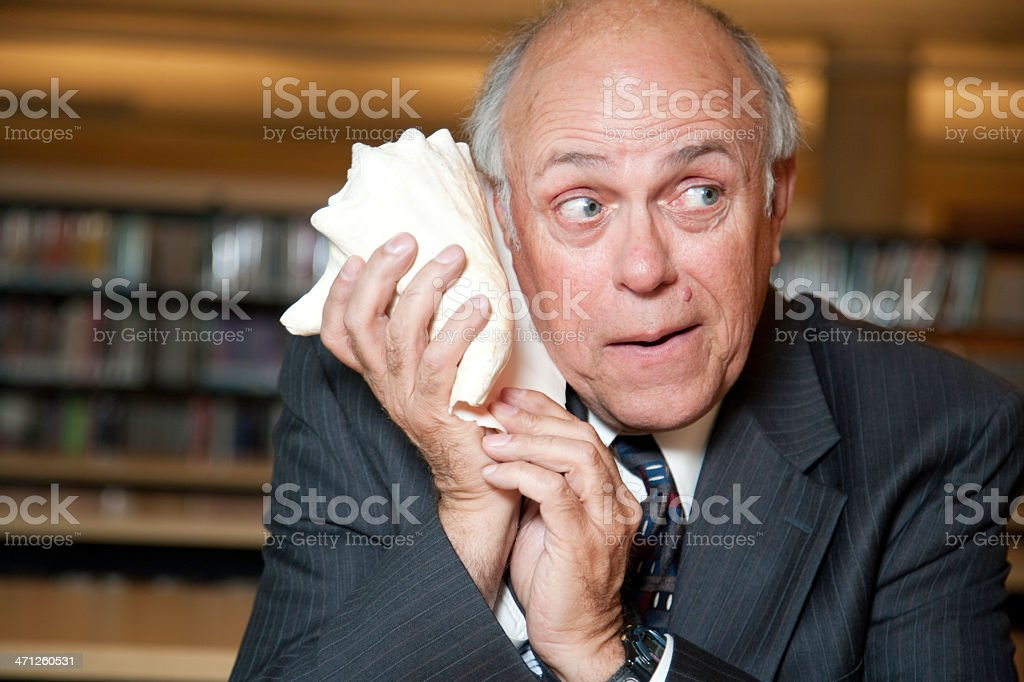 Communication Issues- Older Man Talking on a Shell Phone royalty-free stock photo