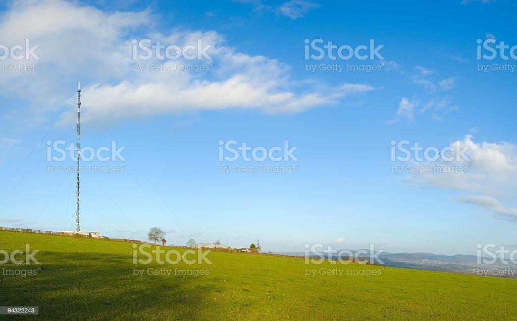 Communication mast and hills royalty-free stock photo