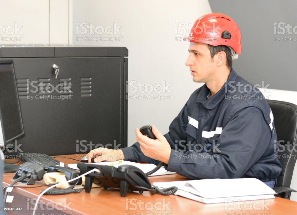 Communication Operator Talking on CB Radio in the Office stock photo