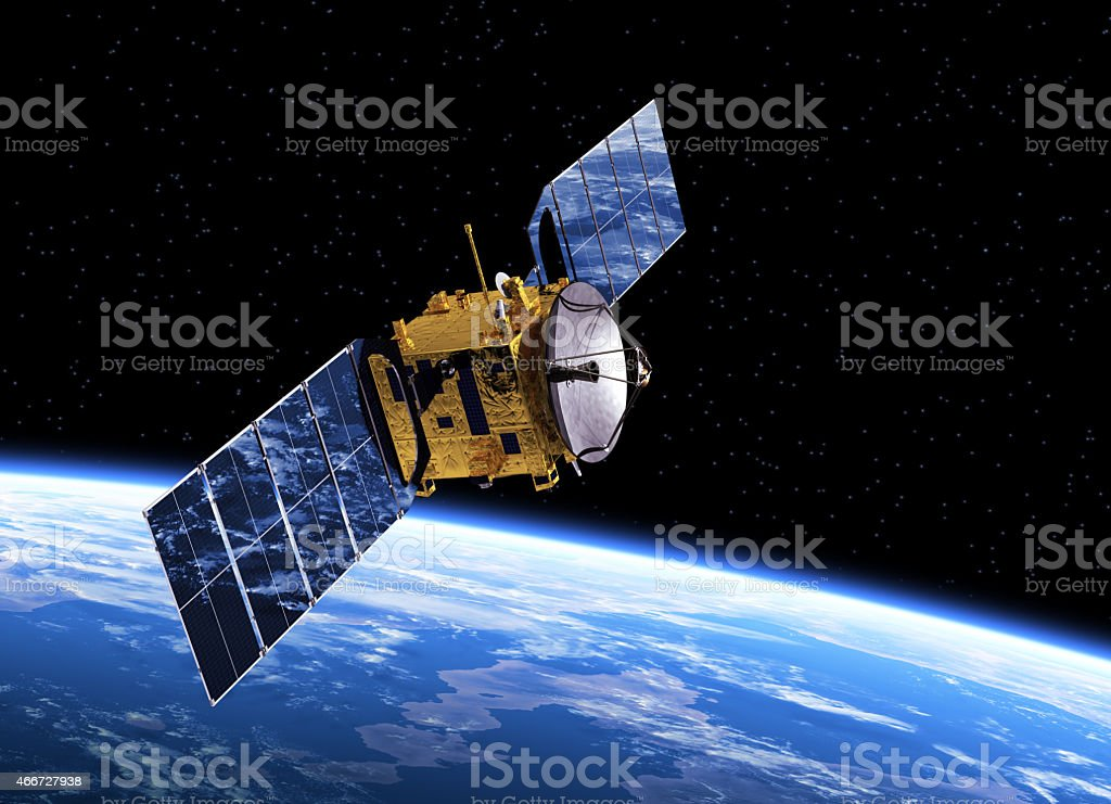 Communication Satellite Orbiting Earth stock photo