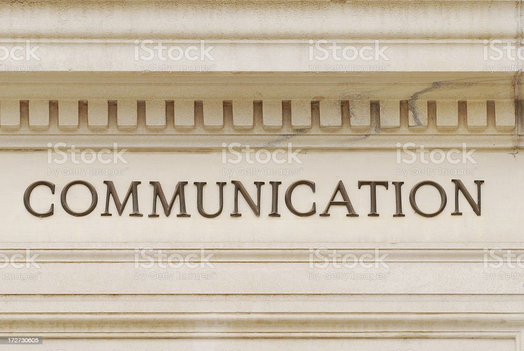 Communication sign on building facade  - Warm royalty-free stock photo