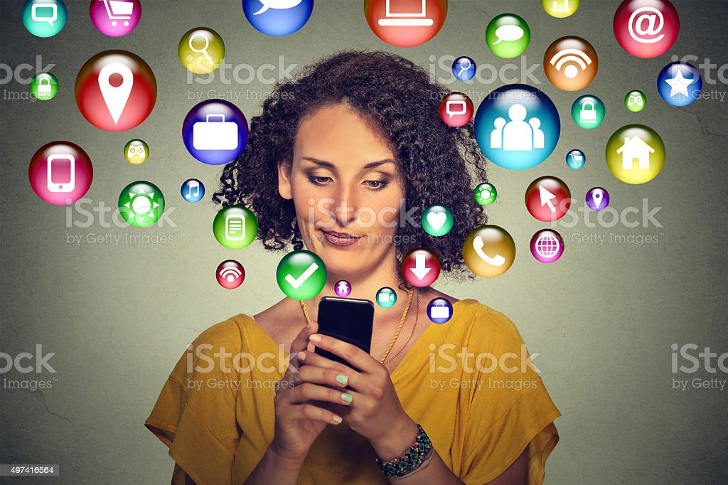 Communication technology. Annoyed woman using smartphone stock photo