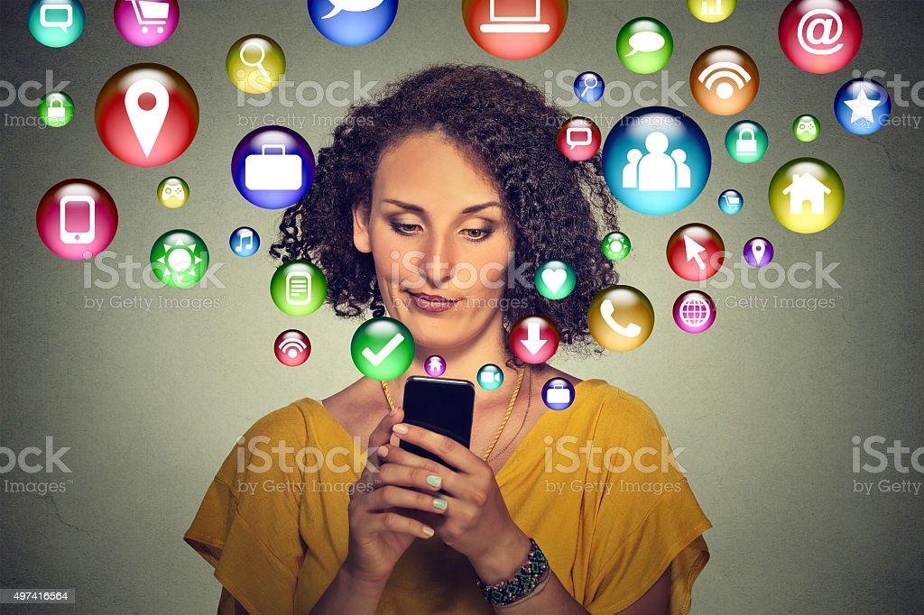 Communication technology. Annoyed woman using smartphone stock photo