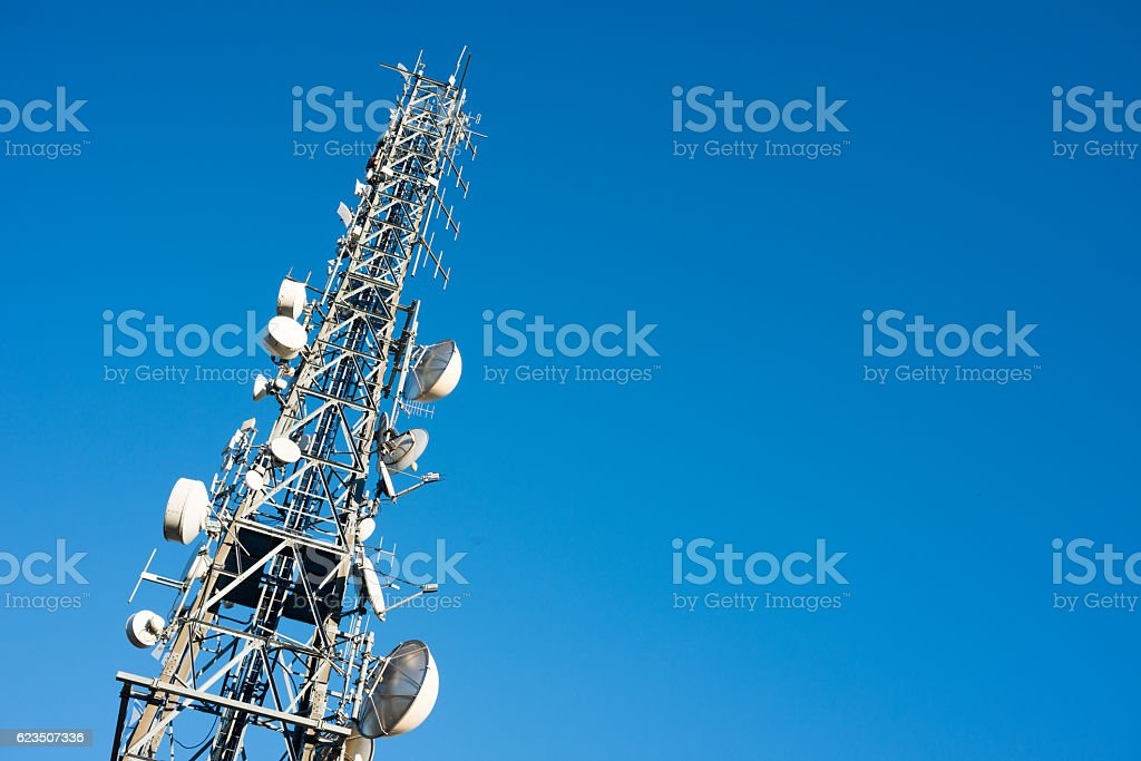 Communication tower against blue sky stock photo