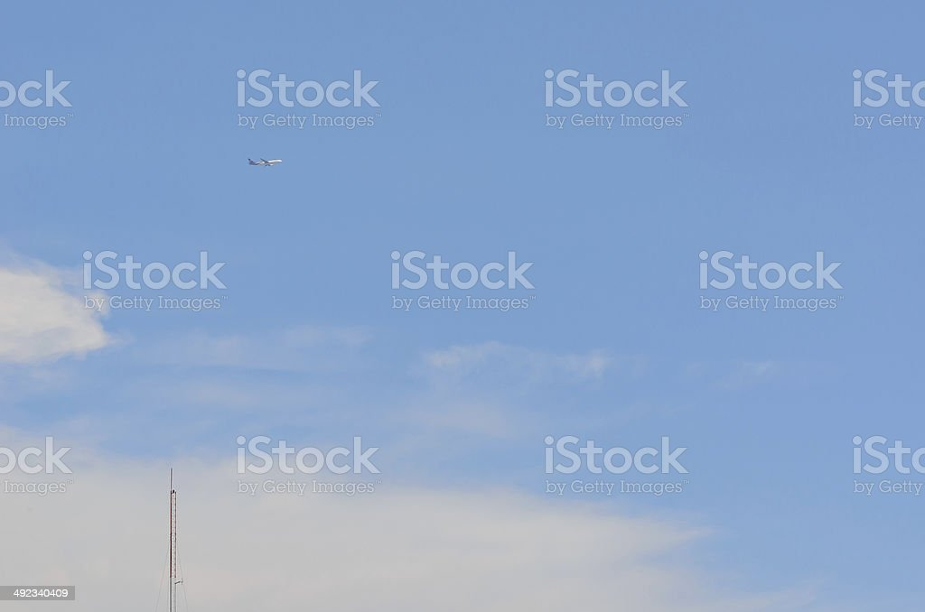 Communication Tower and Airplane stock photo