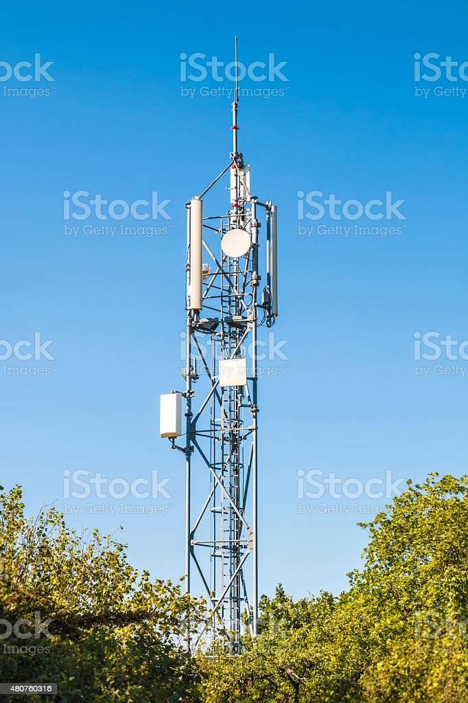 Communication tower antenna in middle of nature stock photo