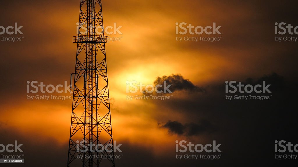 Communication tower in sunset stock photo