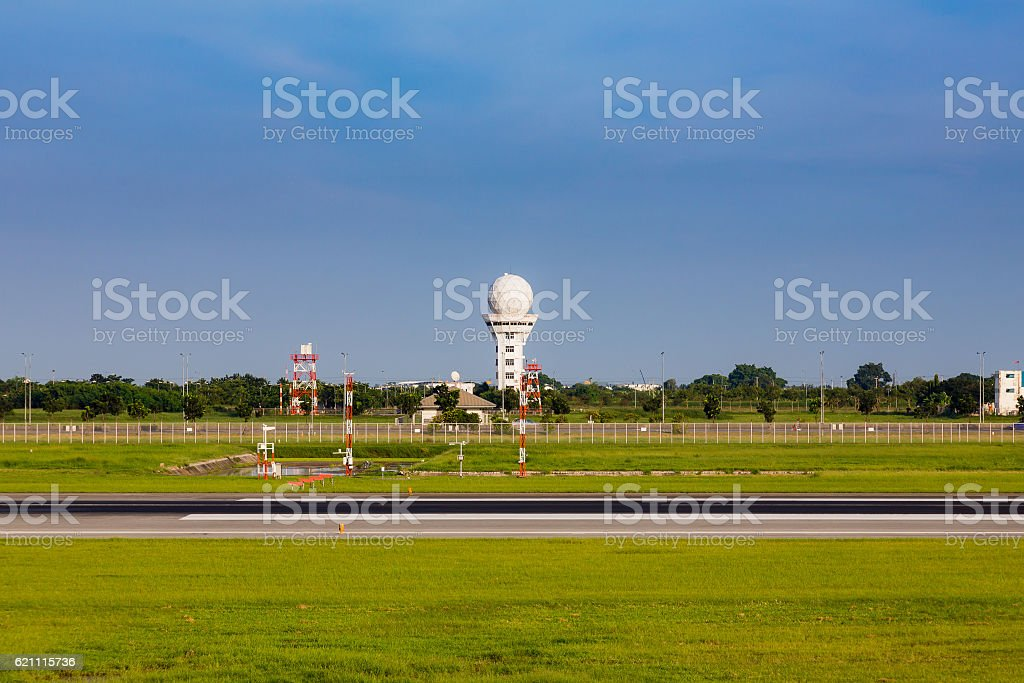 Communication Tower on airport taxi way stock photo
