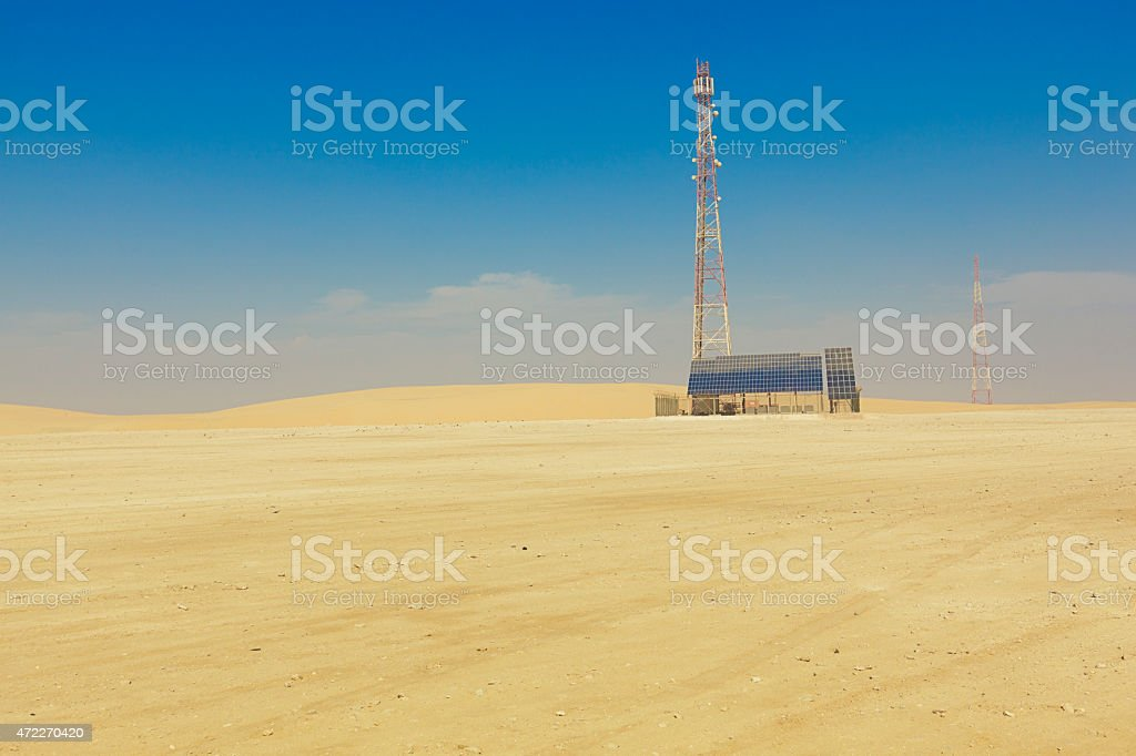 communication tower powered by solar energy stock photo