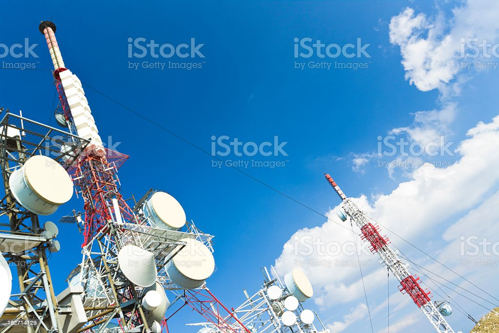 Communication towers stretching across the sky royalty-free stock photo
