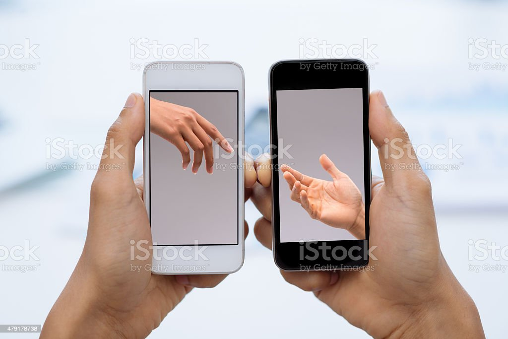 Communication via smartphones stock photo
