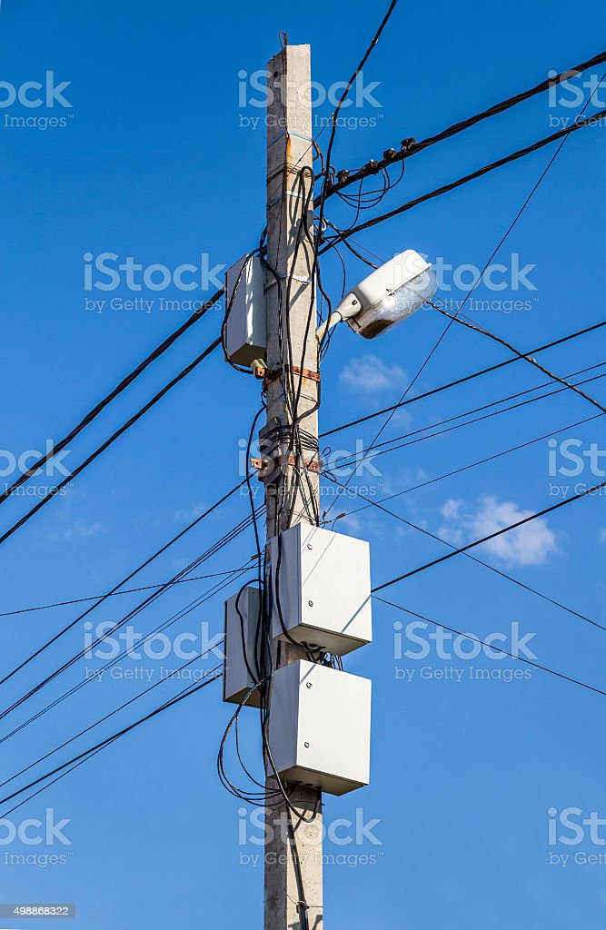 Communication wires on a pole stock photo