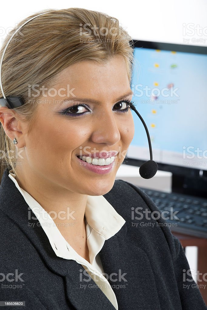 Communication: Woman talking on a headset royalty-free stock photo