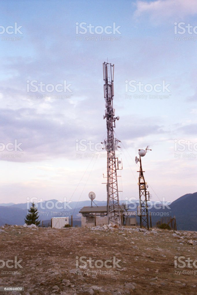 Communications antenna in the high mountains stock photo
