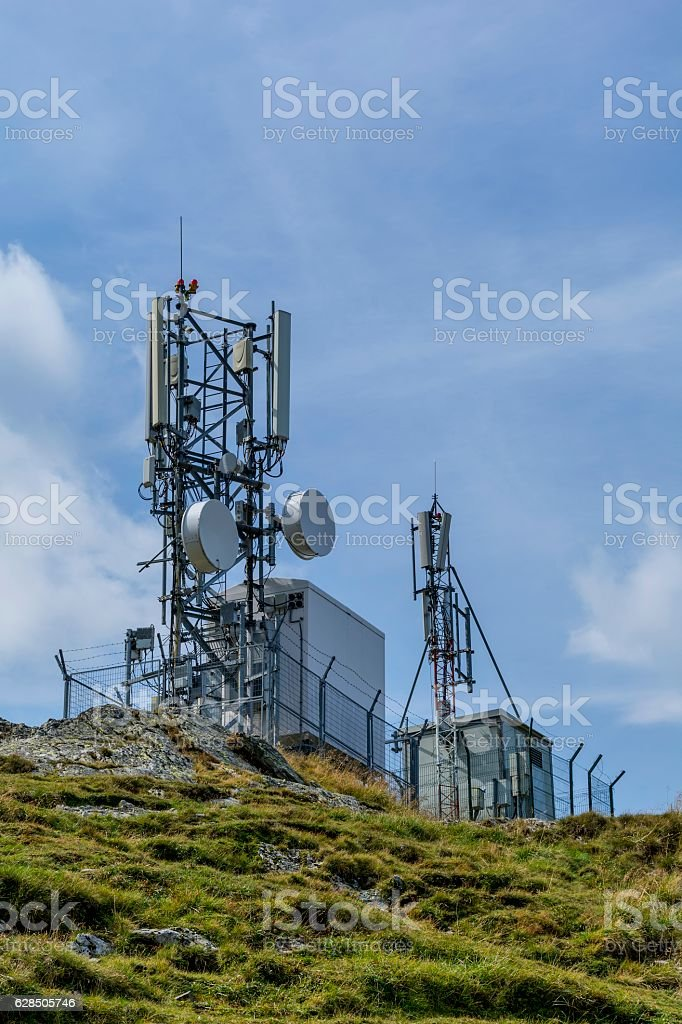 Communications cellular telecoms communications antenna in the high mountains stock photo