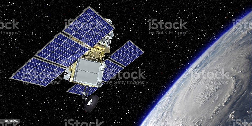 Communications Satellite above the Earth stock photo