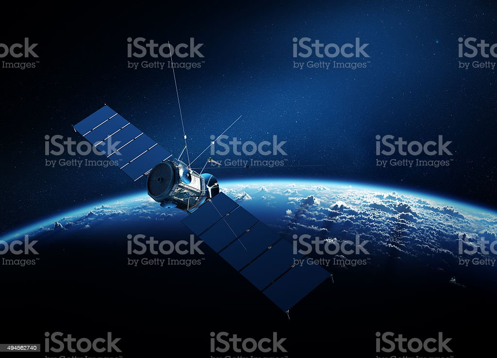 Communications satellite orbiting earth stock photo