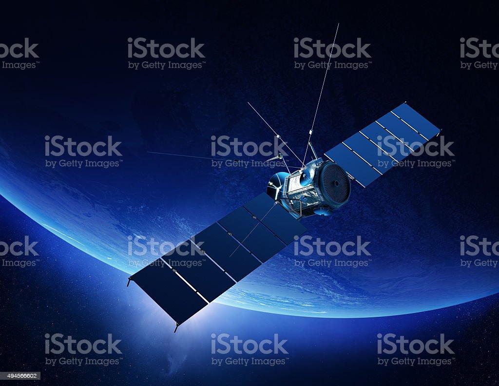 Communications satellite orbiting earth stock photo