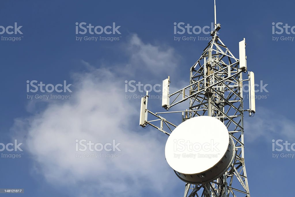 Communications tower against a blue sky stock photo