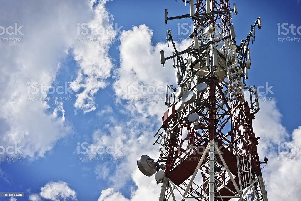 Communications Tower against Blue Cloudy Sky royalty-free stock photo