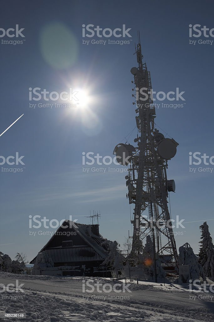 Communications Tower, Winter and Sun stock photo