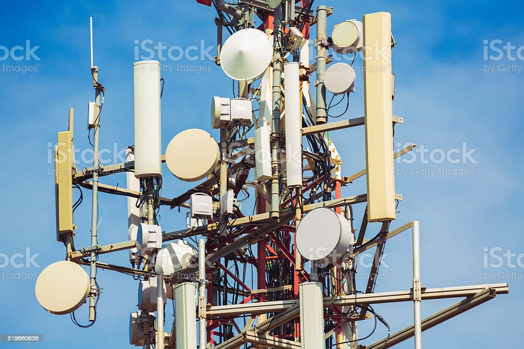 Communications tower with mobile phone antennas. stock photo
