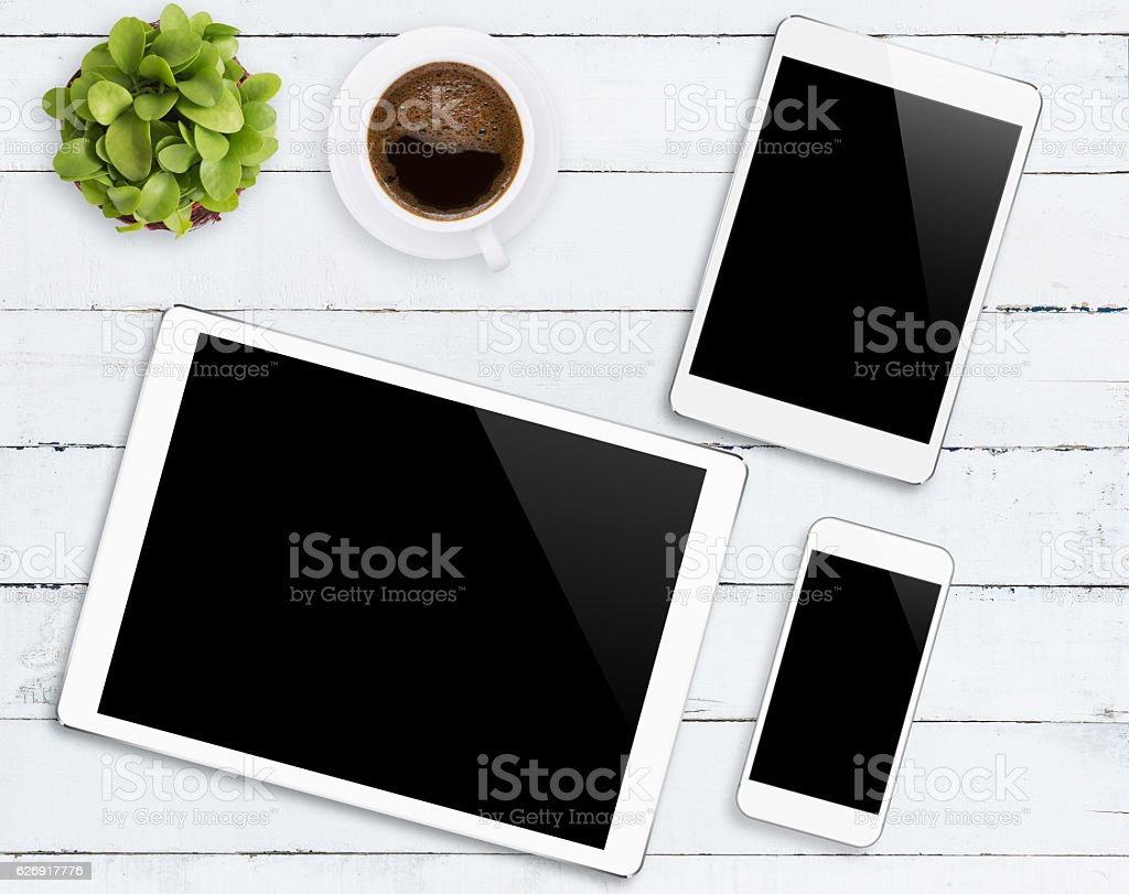 communicator device phone and tablet white color tone on wood stock photo