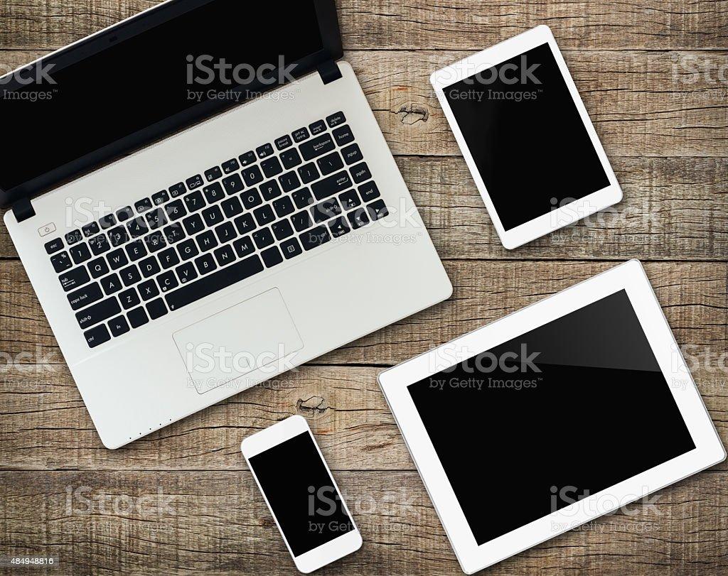 communicator modern electronic device on wood background stock photo