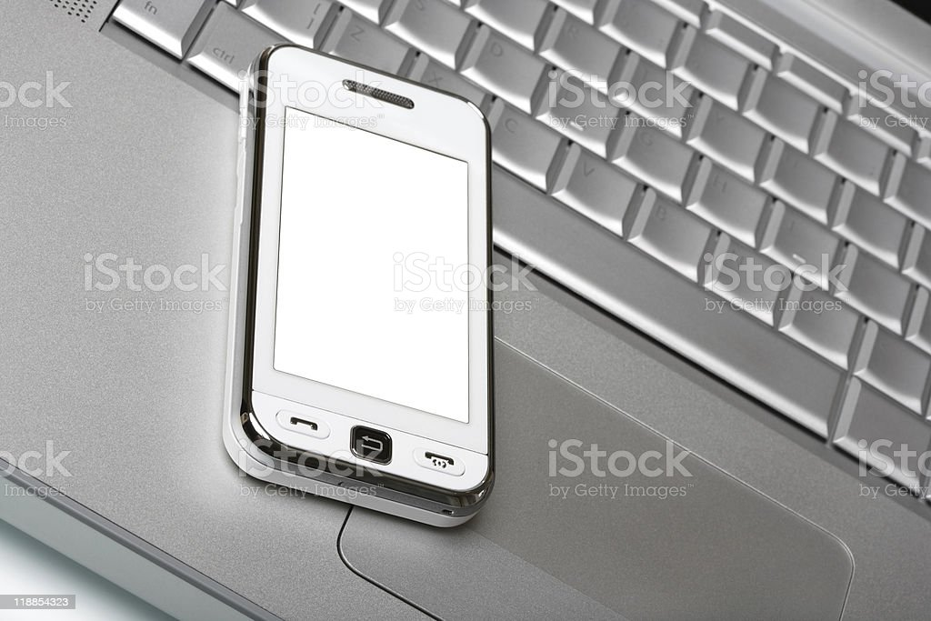 Communicator with white screen on silver laptop. royalty-free stock photo