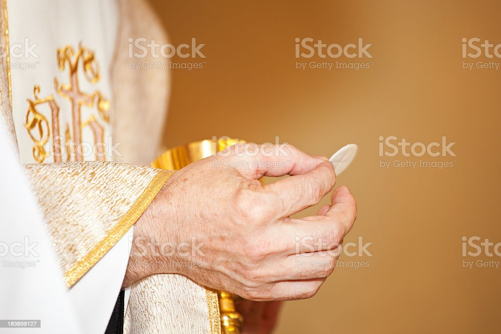 Communion and clergyman royalty-free stock photo