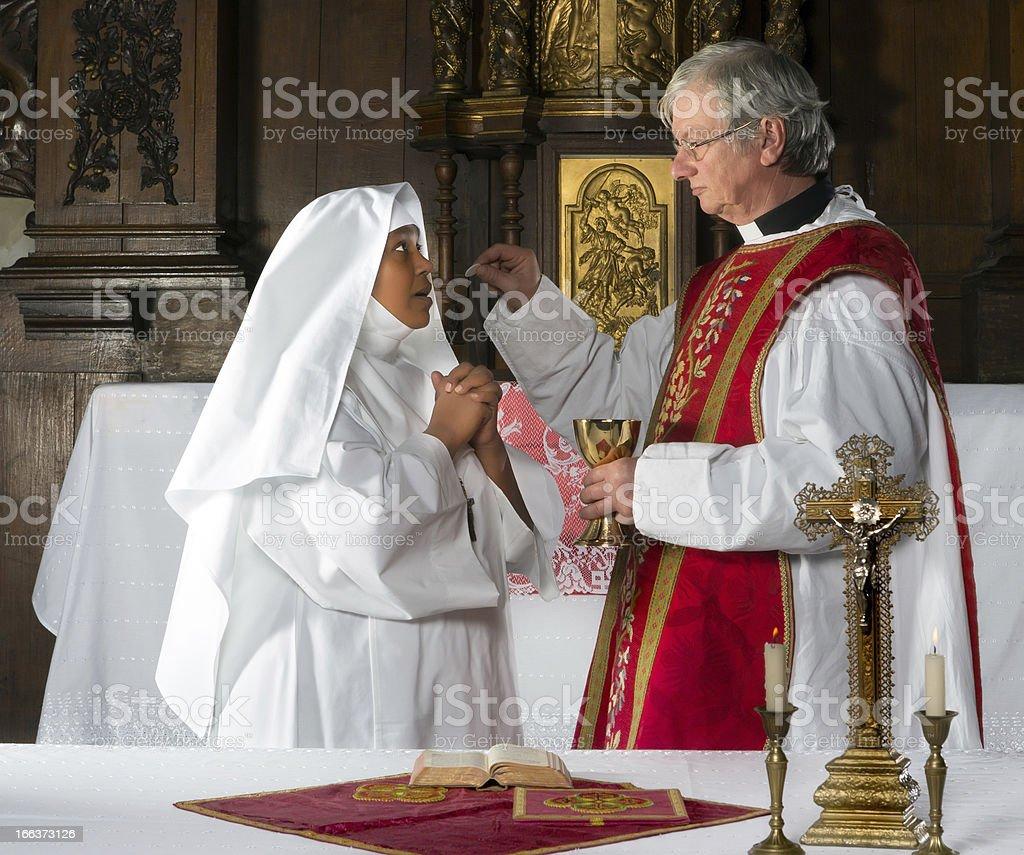 Communion and nun stock photo