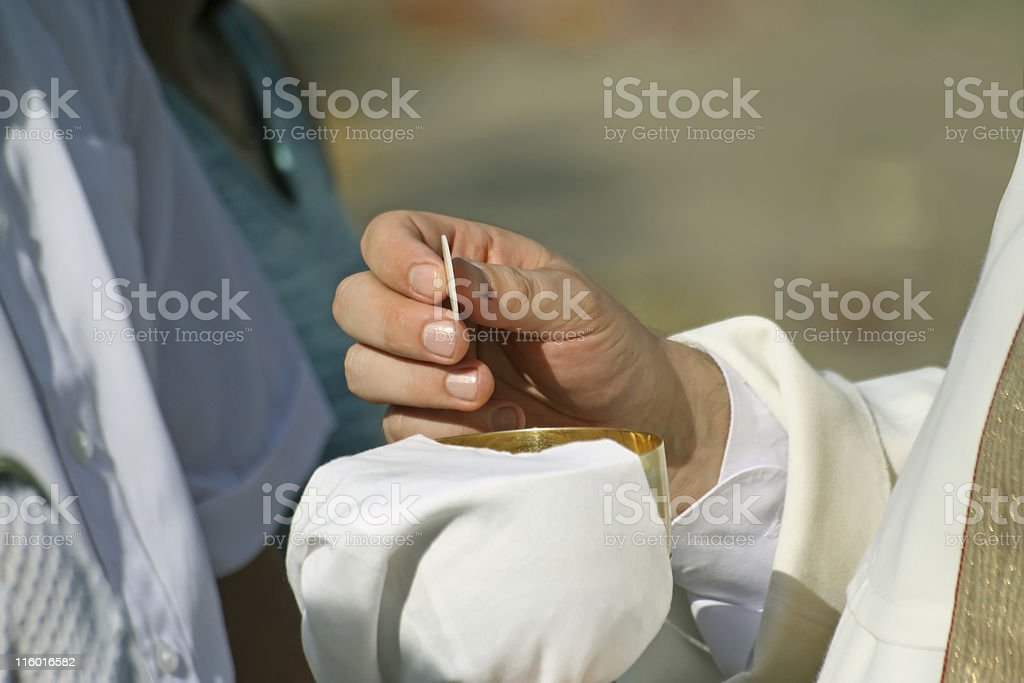 Communion and priest hand stock photo