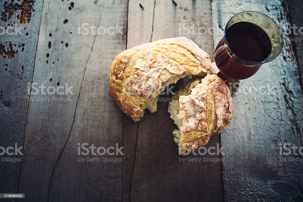 Communion Bread, Wine, and Grapes on Black Background stock photo