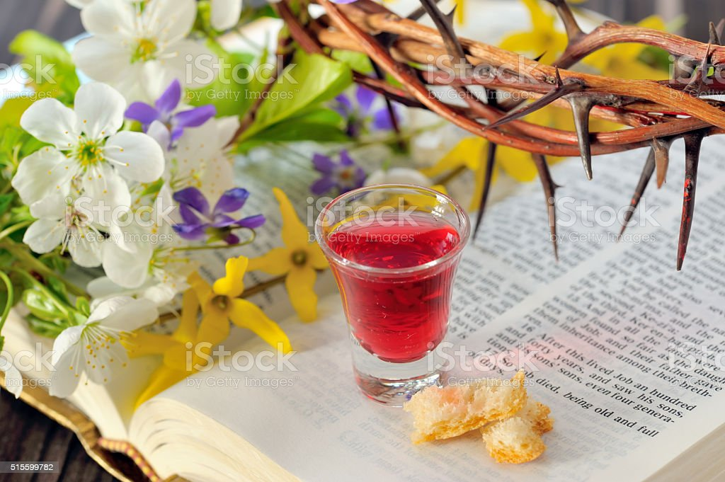 Communion cup with wine and bread stock photo