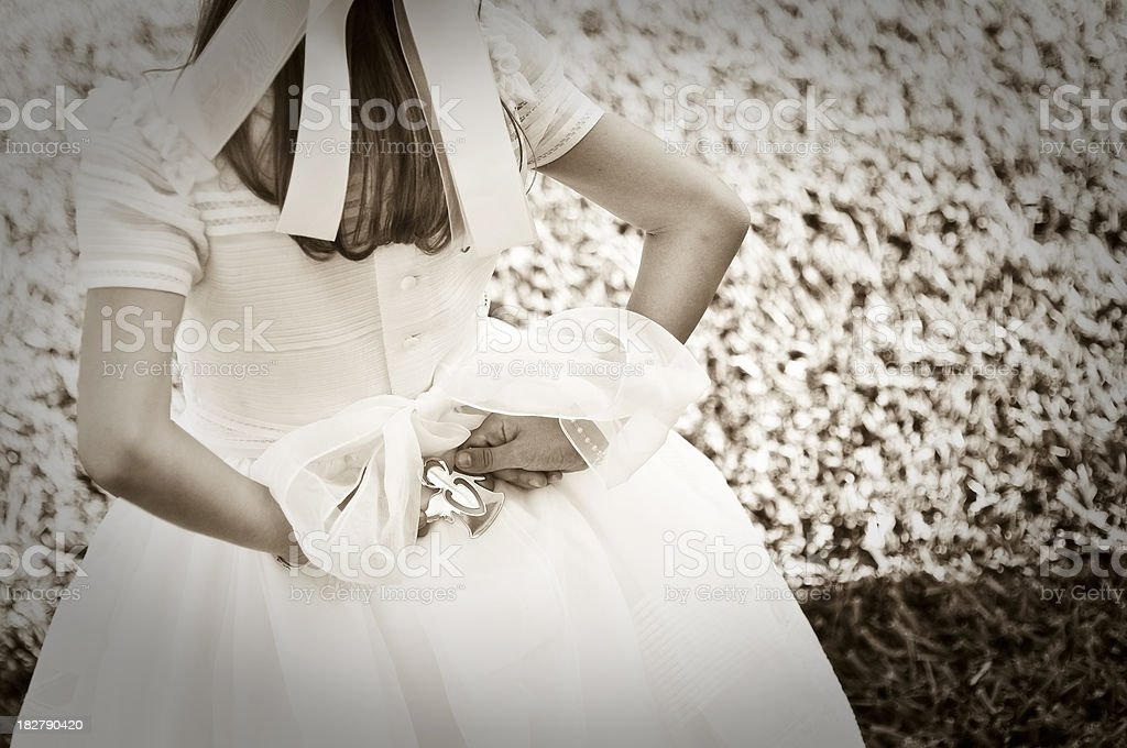 Communion dress and a silver angel stock photo