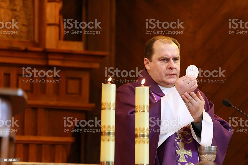 Communion Host and clergy royalty-free stock photo