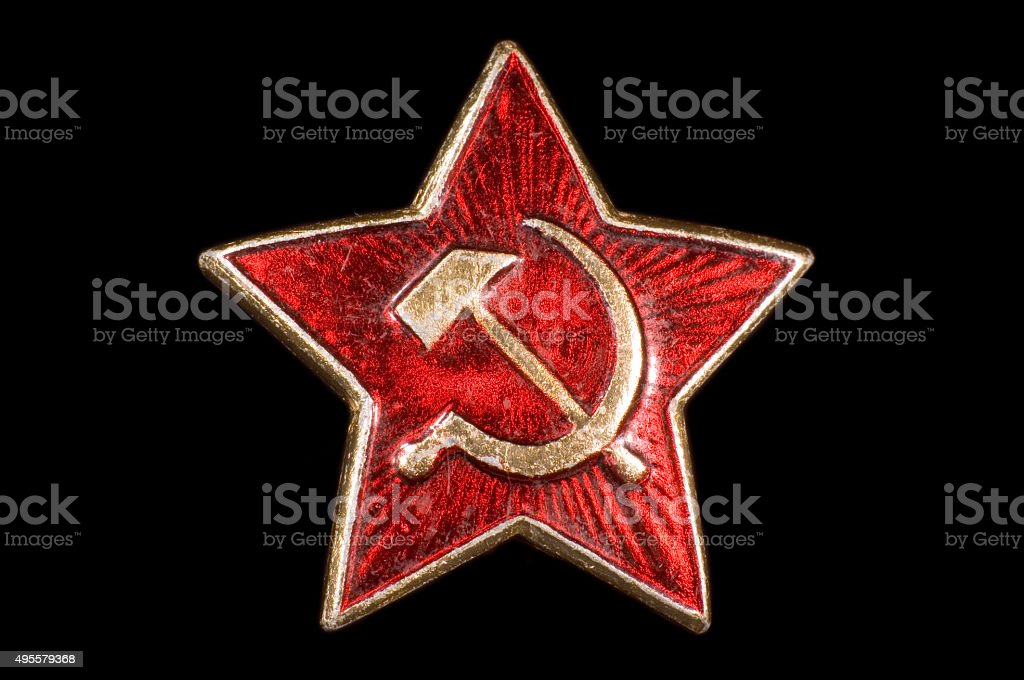 Communist badge, hammer and sickle stock photo