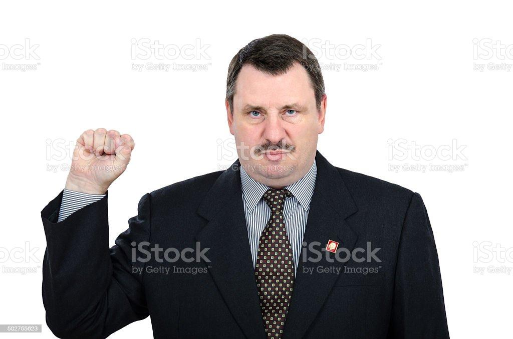 Communist man raising fist stock photo