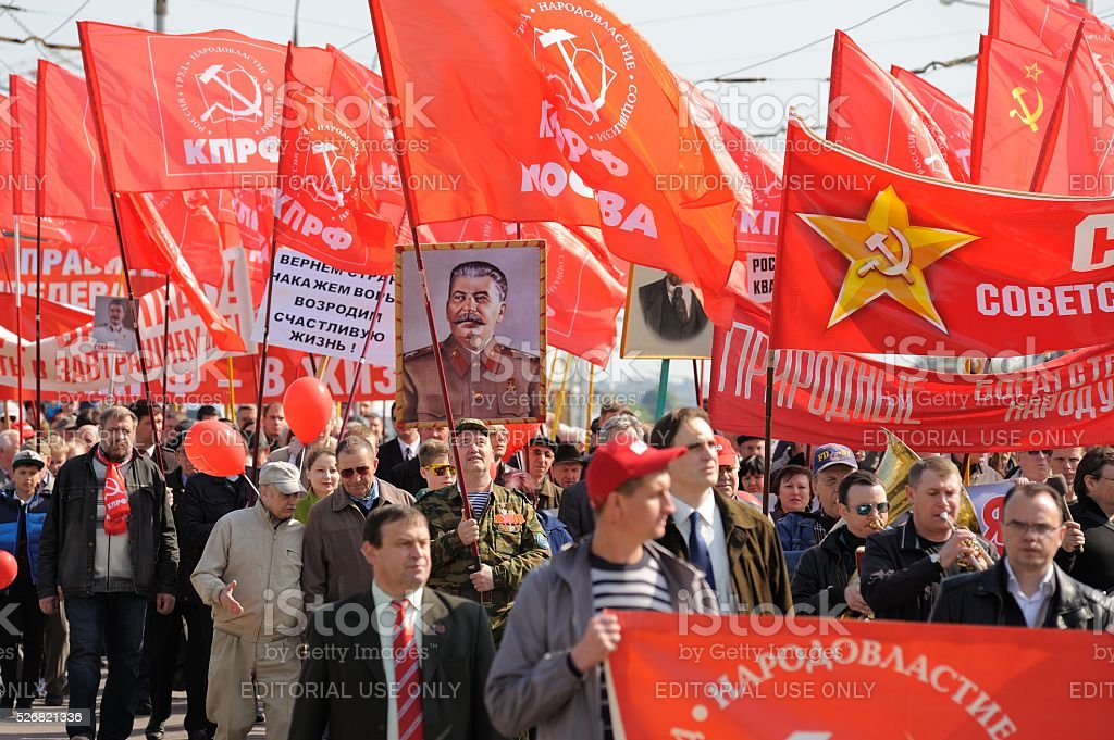 Communist party demonstration.  People carrying red flags and Stalin's portrait stock photo