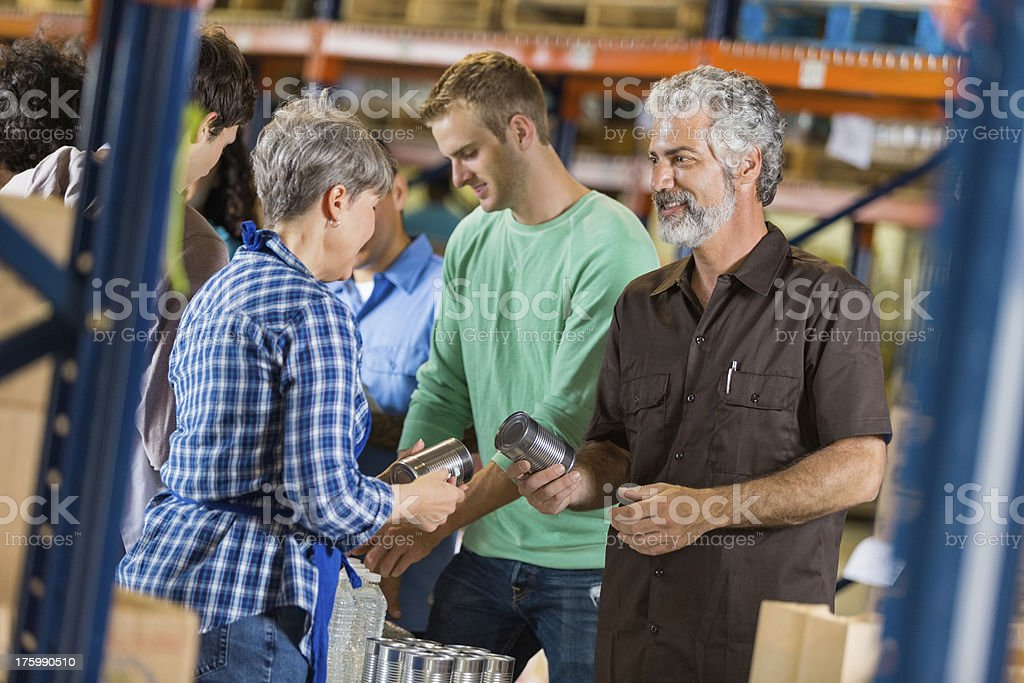 Community donating food for disaster relief stock photo