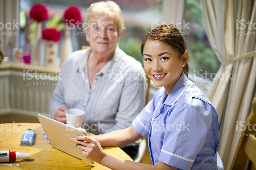 community nurse make a house call to senior royalty-free stock photo