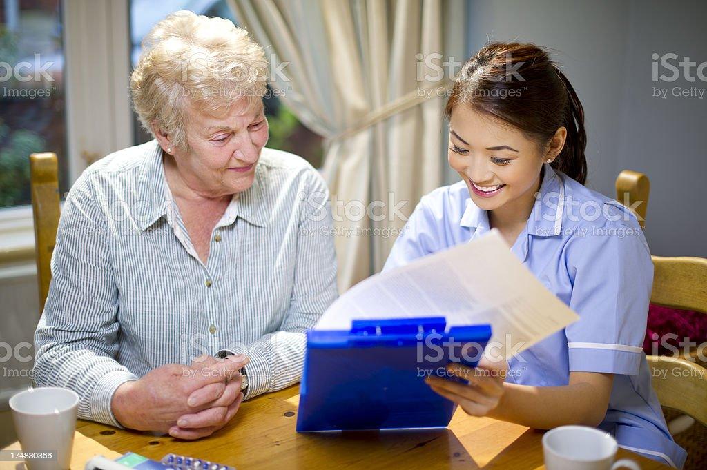 community nurse make a house call to senior royalty-free stock photo