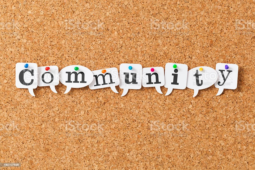 Community on speech bubbles pinned to notice board royalty-free stock photo