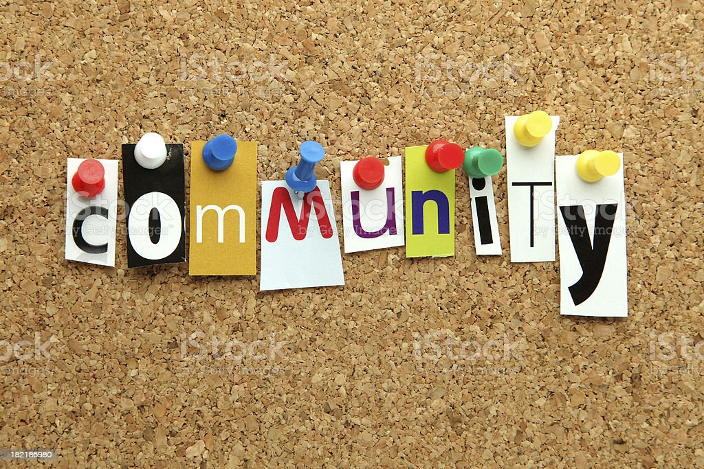 Community word pinned onto a corkboard royalty-free stock photo