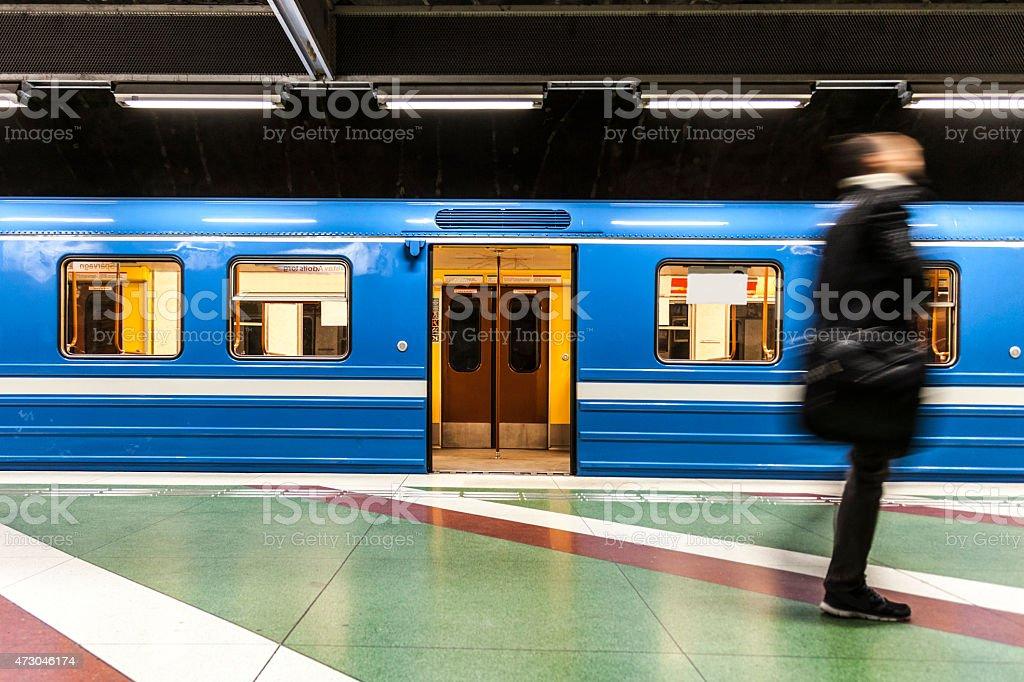 Commuter businessman walking on the subway platform stock photo