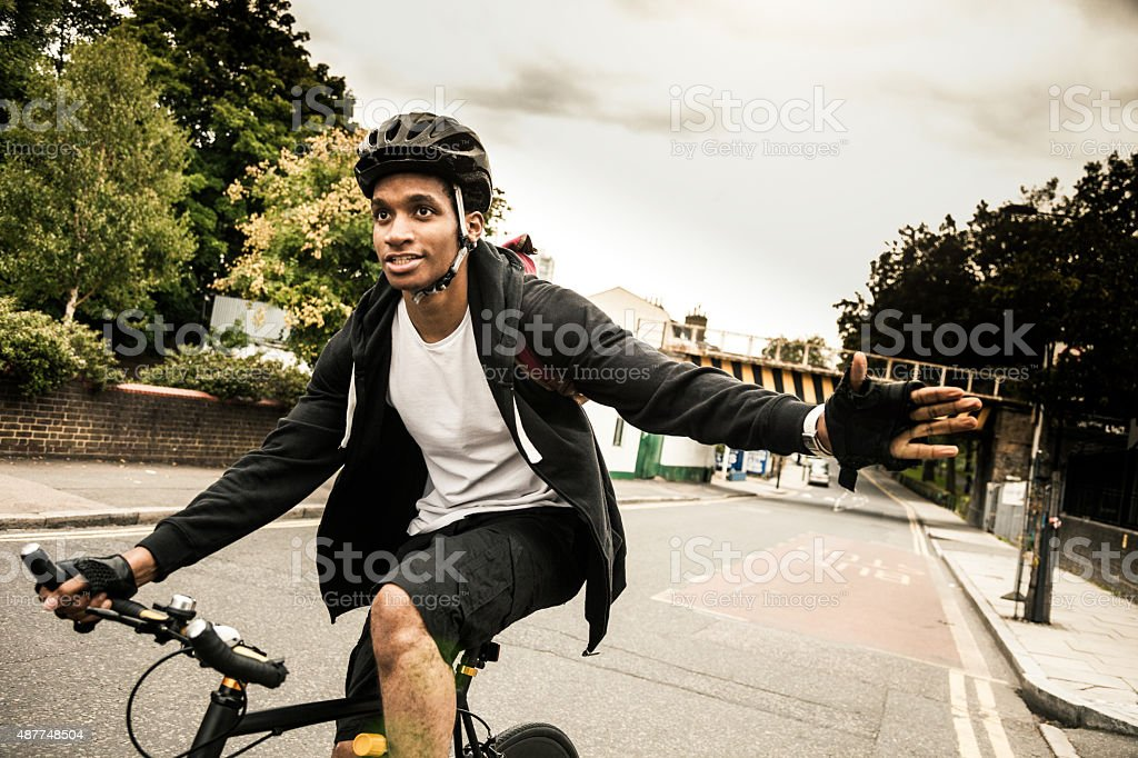 Commuter cycling in Hackney London going at work stock photo