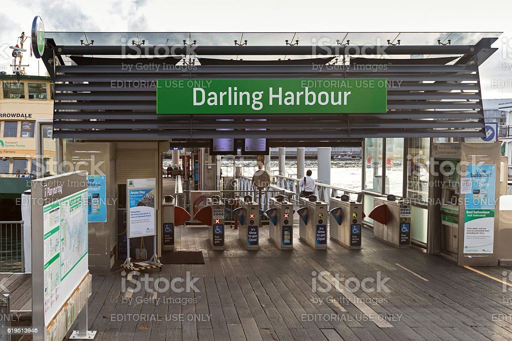 Commuter passing the ticket entrance gate of Darling Harbour, Australia stock photo