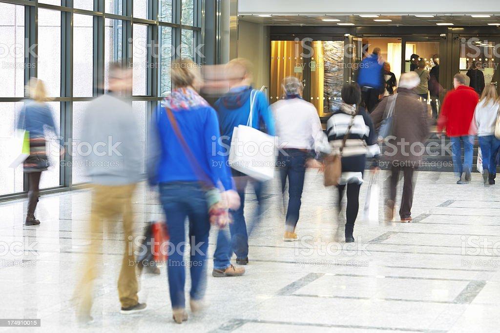 Commuter Stream Walking Along Corridor, Blurred Motion royalty-free stock photo