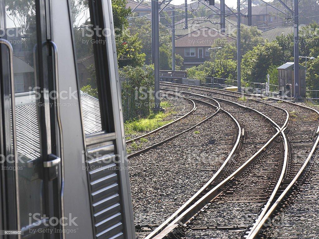 Commuter train and tracks, horizonal stock photo
